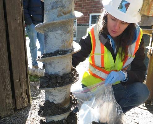 worker testing soil samples